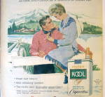 Click to view larger image of 1959 Kool Cigarettes with Woman Sitting On Fence By Man (Image2)