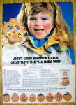 Click to view larger image of 1984 Libby Solid Pumpkin with Girl Holding Cookie (Image1)