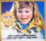 Click to view larger image of 1984 Libby Solid Pumpkin with Girl Holding Cookie (Image2)