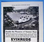 Click to view larger image of 1916 Evinrude Rowboat Motors with People In A Boat (Image2)