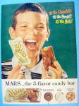 1957 Mars Toasted Almond Bar with Boy Eating Candy Bar
