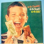 Click to view larger image of 1957 Mars Toasted Almond Bar with Boy Eating Candy Bar (Image2)