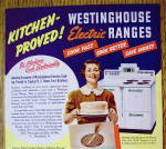 Click to view larger image of 1938 Westinghouse Electric Range w/Woman Holding A Cake (Image2)