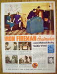 Click to view larger image of 1938 Iron Fireman Heating with Men Looking At Heater (Image1)