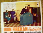 Click to view larger image of 1938 Iron Fireman Heating with Men Looking At Heater (Image2)