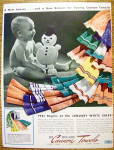 1941 Cannon Towels with Baby Holding Snowman Doll