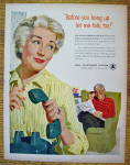 1958 Bell Telephone with Woman Hanging Up Telephone