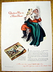 Click here to enlarge image and see more about item 35: 1940 White Owl Cigar with Woman Sitting on Santa's Lap