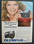 Vintage Ad: 1982 Olympus OM-10 with Cheryl Tiegs