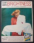 1957 Surf Whitener with Woman Admiring a White Towel