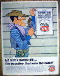 1966 Phillips 66 with Cowboy Hanging Reward Sign
