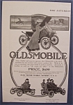 1904 Oldsmobile with a Woman Along Side the Car