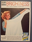 1957 Surf Detergent with Woman Holding a Shirt