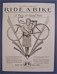 1929 Ride A Bike with a Woman with Bicycle on Shoulders
