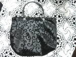 Click to view larger image of Black Handbag with Beaded handles and Tassel Trim (Image1)