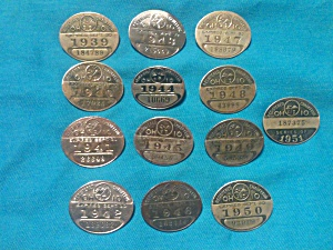 12 Ohio Chauffer Badges 1939-51 (Image1)