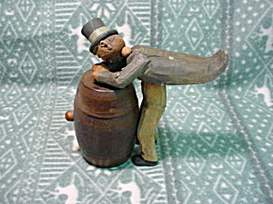 Wooden Carving Man(Drunk) Opening Keg (Image1)