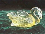 "Click here to enlarge image and see more about item eg12: Yellow 3 1/2"" Cambridge Glass Swan"