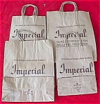 Click here to enlarge image and see more about item I214: (4) Imperial Glass Handled Paper Bags