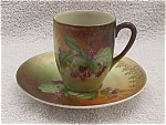 Click here to enlarge image and see more about item pc9: Early Hand Painted Cup & Saucer