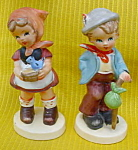 Click here to enlarge image and see more about item rdd22: Pr. of Hummel-Like Figurines Boy/Girl