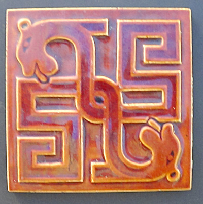 Maw Geometric Tile  with Opposing Dogs Heads  (Image1)