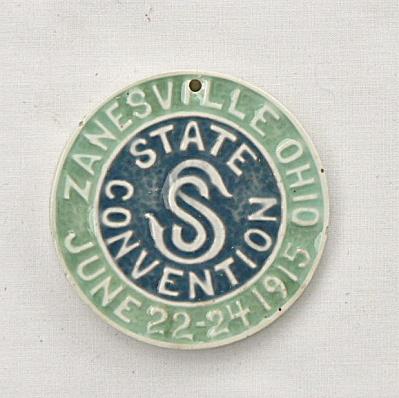 American Encaustic 1915 Round Tile Token (Image1)