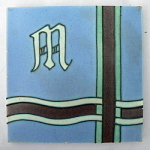 Architectural Tile with Initial Blue Background