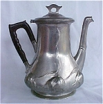 "This is an outstanding piece of pewter made by Orivit (Germany).  Dating at circa 1900, this teapot measures 8 1/4"" high and about 5 1/2"" at its largest diameter.  Heavily pressed out design..."
