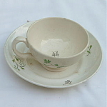 Click here to enlarge image and see more about item T2024: Childs Porcelain Cup Saucer early 1800's