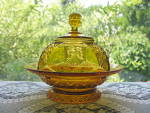 Click here to enlarge image and see more about item A223: Antique Eapg Amber Hartley Butter Dish