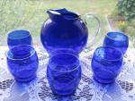 Click here to enlarge image and see more about item DG102: Elegant Dep. Era Cobalt Blue Juice Pitcher & Tumblers