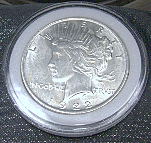 Peace Silver Dollar 1922 plastic encased. (Image1)