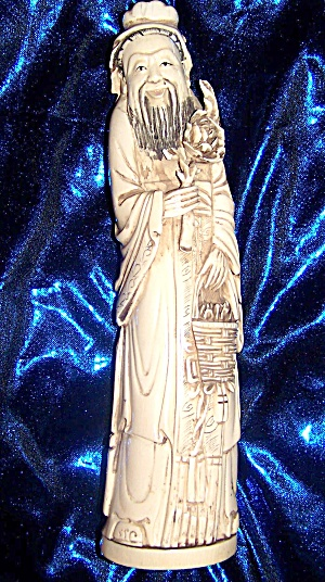 "Ivory figurine 10"" of oriental man w/ basket. (Image1)"