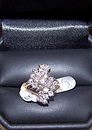 Ladies 14kt  y.g. cluster style ring w/ 23 diamonds. (Image1)