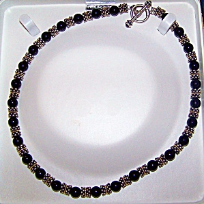 Necklace with 14k y. gold, sterling silver, onyx, and garnet stones. (Image1)