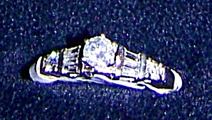 Ladies platinum ring with round brilliant and baguette cut diamonds (Image1)