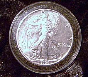 Silver Dollar Liberty Walking 1990 Plastic Encased.