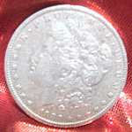 Click here to enlarge image and see more about item 012208004: Morgan Silver Dollar 1880 O in mint condition.