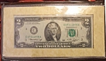 Click here to enlarge image and see more about item 020608001: 1976 1st Day Issue $2 Bicentennial Note w certification