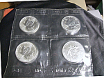 Click here to enlarge image and see more about item 040209001: LOT OF 4 1990 CANADIAN SILVER MAPLE LEAF $5 COINS