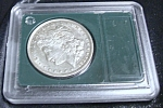 Click here to enlarge image and see more about item 032008003: 1921 Morgan Silver Dollar, sealed, beautiful mint cond!