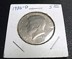 Click here to enlarge image and see more about item 033108004: Kennedy Half Dollar 1986-D
