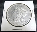 Click here to enlarge image and see more about item 040808001a: Morgan Silver Dollar 1879-O RARE MINT UNCIRCULATED.