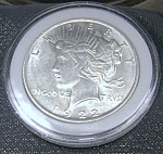 Click here to enlarge image and see more about item 041608003: Peace Silver Dollar 1922 plastic encased.