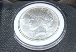 Click here to enlarge image and see more about item 041608004: Peace Dollar 1923 plastic encased.