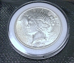 Click here to enlarge image and see more about item 041608005: Peace Silver Dollar 1923 plastic encased.