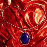 Click here to enlarge image and see more about item 042508003: Antique sterling silver necklace with blue stone