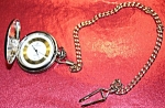 Click here to enlarge image and see more about item 042908003: Dakota Co. Berenger Pocket watch with Arabic nos. on gilt background
