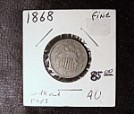 Click here to enlarge image and see more about item 052708009: Shield Nickel 1868 without rays.